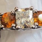 diamond and orange stones, platinum engagement ring,