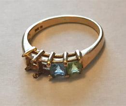 ring with stones out of it, aquamarine and peridot ring with stones missing