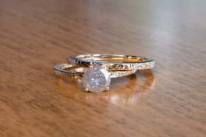uncut diamond, custom hammered finish engagement ring and wedding band