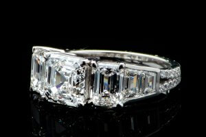 three carat asscher engagement ring with trapezoid accent diamonds and emerald cut sides