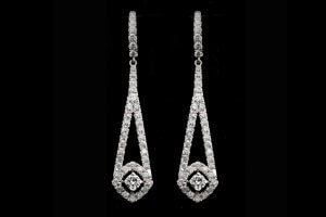 vintage style diamond dangle earrings with halo