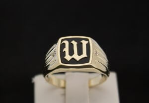 W initial ring made in yellow gold with black onyx inlay and diamond accents