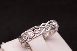 celtic knot white gold ring with four round diamonds with milgrain