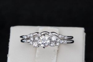 trendy engagement ring with small accents on the side of center diamond