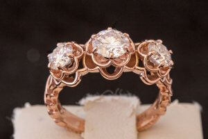 three flower engagement ring in rose gold and diamonds