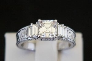 engagement ring in 14k white gold with two straight baguette diamonds on either side of an asscher cut diamond