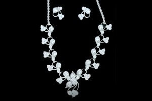 diamond white gold earring and necklace set flower design