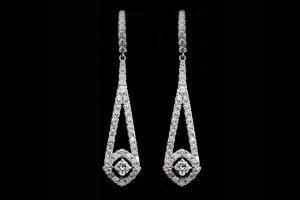 vintage style diamond dangle earrings with halo