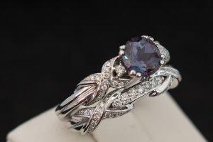 custom round alexandrite engagement ring with criss cross diamond pattern and wedding ring