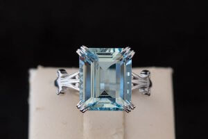 large aquamarine in an emerald cut shape set in a white gold fashion ring setting