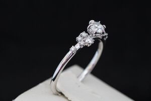 dainty diamond accented cluster engagement ring