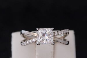 engagement ring with an x pattern with diamond accents