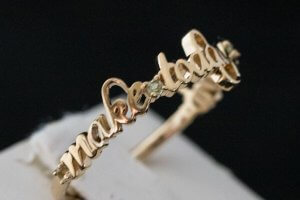 make today count phrase fashion ring with peridot stones between words in 18k yellow gold