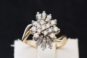 round diamonds and baguette diamonds set in cluster style 14k yellow gold ring