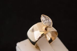 8mm wide engagement ring in yellow gold with a bezel set marquise